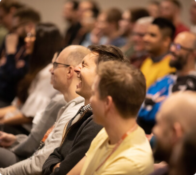 quality-conference-crowd-laughing